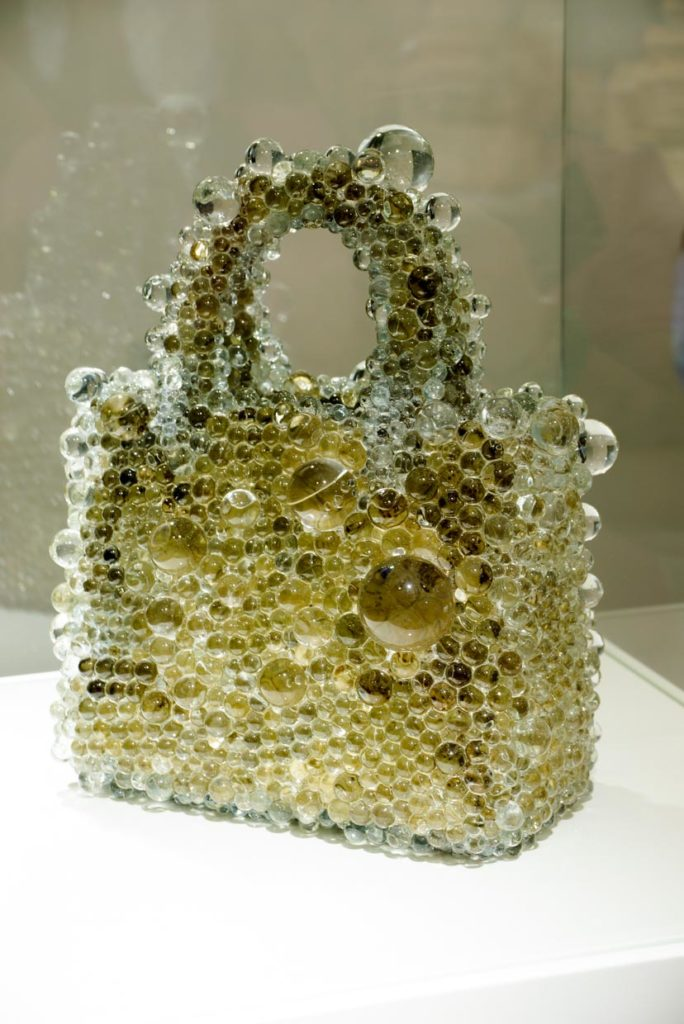 Artist: Kohei Nawa- Pixcell-Bag 2011, Glass Lenses on Leather.